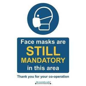 Face masks are still mandatory in this area sign