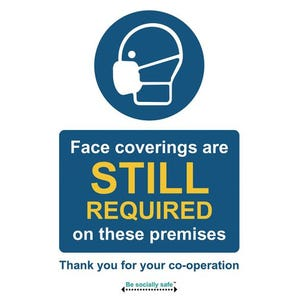 Face coverings are still required on these premises sign