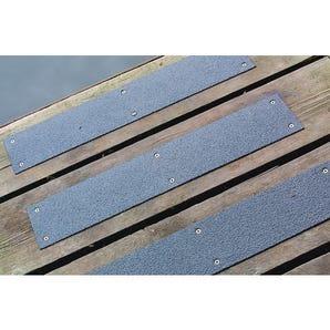 Stainless steel slip resistant floor cleats