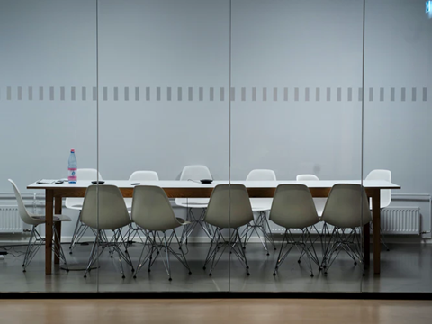 A meeting table in an office space